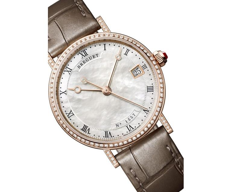 The white dial fake watch is decorated with diamonds.