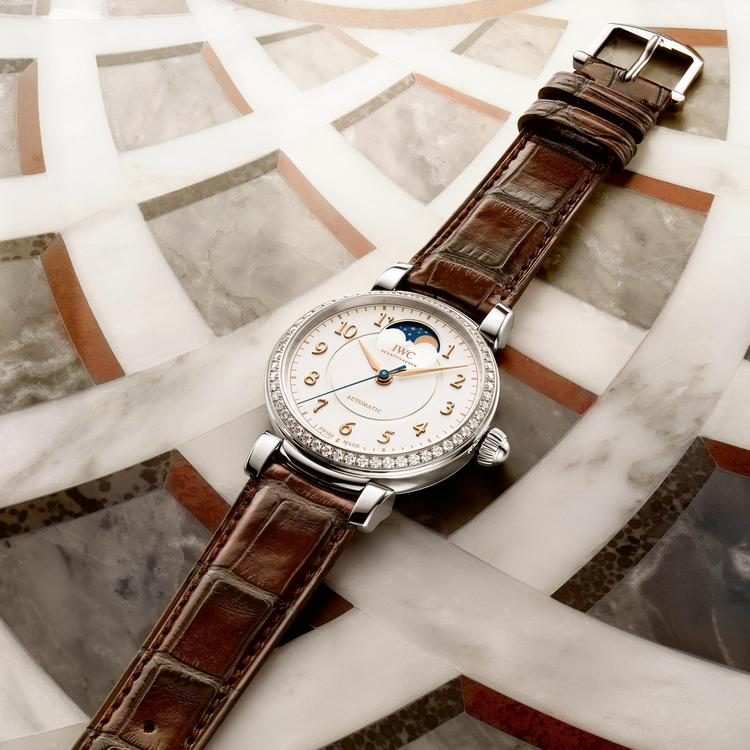 The white dial fake watch has a brown strap.