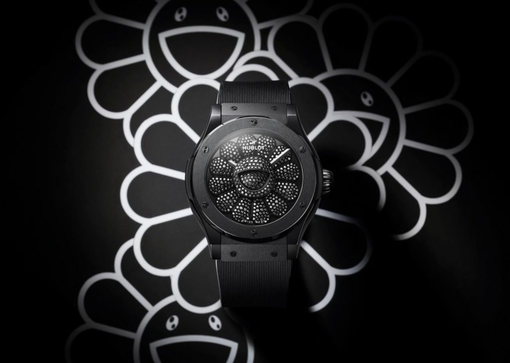 The black ceramic fake watch has a black dial.