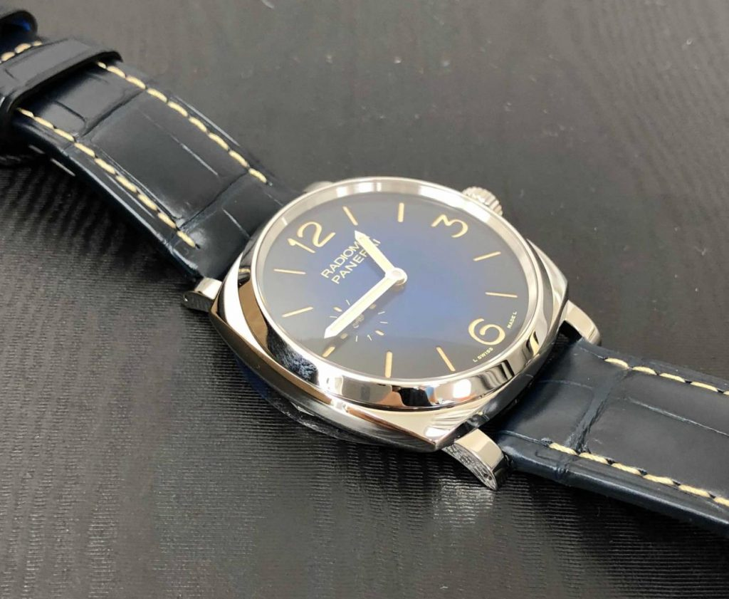 The stainless steel fake watch has a blue strap.
